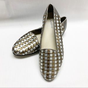Trotter gold and silver woven leather flats.